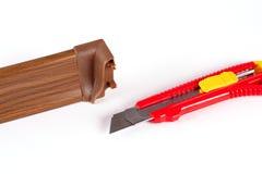 Plinth en plastique avec le couteau Photos stock