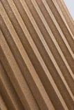 Plisserad guld- kjol Abstrakt begrepp specificerar Slapp fokus Härlig bakgrund Royaltyfri Foto