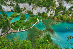 PLITVICE, CROATIA - JULY 29: Tourist enjoy sightseeing the lakes and wonderful landscapes at the Plitvice natural Park in Croatia Royalty Free Stock Photos