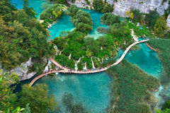 PLITVICE, CROATIA - JULY 29: Tourist enjoy sightseeing the lakes and wonderful landscapes at the Plitvice natural Park in Croatia Stock Image