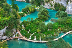 PLITVICE, CROATIA - JULY 29: Tourist enjoy sightseeing the lakes and wonderful landscapes at the Plitvice natural Park in Croatia Stock Images