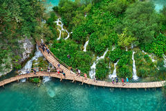 PLITVICE, CROATIA - JULY 29: Tourist enjoy sightseeing the lakes and wonderful landscapes at the Plitvice natural Park in Croatia Royalty Free Stock Images