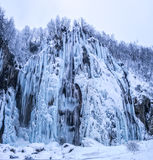 Plitvice lakes frozen large waterfall Royalty Free Stock Photo