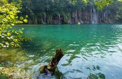 Plitvice Lakes National Park, Croatia. Beautiful summer waterfalls and green  limpid lake in Plitvice Lakes National Park (Croatia Stock Images