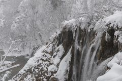 Plitvice Lakes National Park, snow covered nature. Natural landscape of frozen Plitvice Lakes National Park. Stock Image