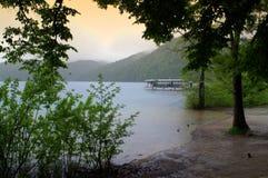 Plitvice lakes shore in the rain Stock Photography