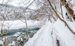 Plitvice lakes snowy winter. Walking trail in snowy winter at Plitvice lakes in Croatia Royalty Free Stock Photo