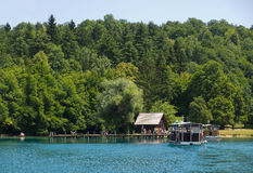 Plitvice National Park. PLITVICE, CROATIA - JULY 7: Tourist enjoy sightseeing the lakes and wonderful landscapes at the Plitvice natural Park in Croatia during Stock Photography