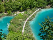 Plitvice National Park. PLITVICE, CROATIA - JULY 7: Tourist enjoy sightseeing the lakes and wonderful landscapes at the Plitvice natural Park in Croatia during Royalty Free Stock Images