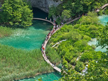 Plitvice National Park. PLITVICE, CROATIA - JULY 7: Tourist enjoy sightseeing the lakes and wonderful landscapes at the Plitvice natural Park in Croatia during Stock Images