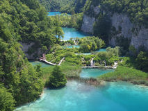 Plitvice National Park. PLITVICE, CROATIA - JULY 7: Tourist enjoy sightseeing the lakes and wonderful landscapes at the Plitvice natural Park in Croatia during Stock Image