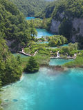 Plitvice National Park. PLITVICE, CROATIA - JULY 7: Tourist enjoy sightseeing the lakes and wonderful landscapes at the Plitvice natural Park in Croatia during Royalty Free Stock Photography