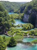 Plitvice natural Park in Croatia. PLITVICE, CROATIA - JULY 7: Tourist enjoy sightseeing the lakes and wonderful landscapes at the Plitvice natural Park in Royalty Free Stock Photography