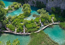 Plitvice natural Park in Croatia. PLITVICE, CROATIA - JULY 7: Tourist enjoy sightseeing the lakes and wonderful landscapes at the Plitvice natural Park in Stock Photo