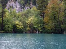 Plitwitz lake. Forest on the shoreline and a waterfall in Lake Plitwitz, Croatia Royalty Free Stock Images