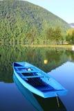 Pliva Lake 1. A sky blue colored boat on Pliva Lake in the morning, Jajce, Bosnia and Herzegovina Royalty Free Stock Photos
