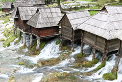 Pliva Lake Watermills. Wooden huts housing the traditional watermills at Pliva Lake in Jajce, Bosnia Stock Photo