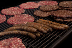 Pljeskavica. Grilling burgers and sausages on the charcoal Stock Images