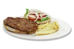 Pljeskavica. Serbian burger patty called Pljeskavica Royalty Free Stock Images