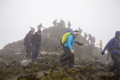 PLLandudno, Wales, UK - MAY 27, 2018 people climbing down from the mountain. Mountaineers descending from the mountain. Group back stock image