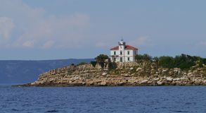 The Plocica lighthouse in the Adriatic sea of Croatia Stock Images