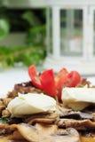 Plocka svamp en lakräm Fotografering för Bildbyråer