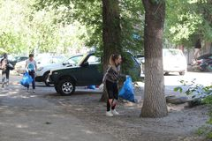 Plogging. girls run and collect garbage in bags on the streets Saratov, Russia, 10 June 2018. Plogging. girls run and collect garbage in bags on the streets royalty free stock photo