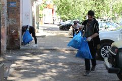 Plogging. young people run and collect garbage in bags on the streets of Saratov, Russia, June 10, 2018. Plogging. young people run and collect garbage in bags royalty free stock images