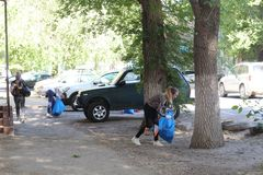 Plogging. young people run and collect garbage in bags on the streets of Saratov, Russia, June 10, 2018. Plogging. young people run and collect garbage in bags royalty free stock photography