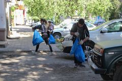 Plogging. young people run and collect garbage in bags on the streets of Saratov, Russia, June 10, 2018. Young people run and collect garbage in bags on the royalty free stock image