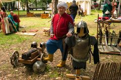 Ploiesti, Romania - July 14, 2018: Actor dressed up ottoman turk warrior poses surrounded by medieval weapons, cannon, swords and stock photo