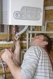 Plombier au travail Images libres de droits