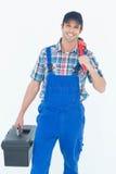 Plombier avec la clé de singe et la boîte à outils Photo stock