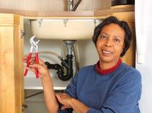 Plombier féminin noir Photos libres de droits