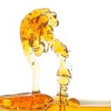 Plons van olie in een abstracte vorm in het water. Royalty-vrije Stock Afbeeldingen