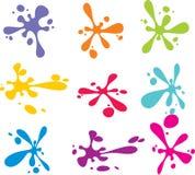 Plonsen van kleurrijke inkt op wit Royalty-vrije Stock Afbeeldingen