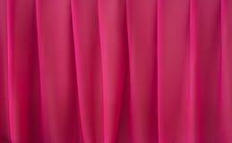 Plooiende elegante roze chiffon of satijntextuur als achtergrond Stock Foto