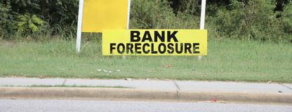 Foreclosure Bank Property. A plot of land that has been foreclosed on by the bank and  is being auctioned off to the highest bidder Stock Images