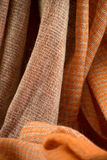 PLOT SCARF FABRIC PASHMINE. COLOUR ORANGE,TRAMA SCIARPE IN TESSUTO PASHMINE DI COLORAZIONE ARANCIONE Stock Photo