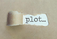 Plot. Torn brown paper revealing the word plot Stock Photo