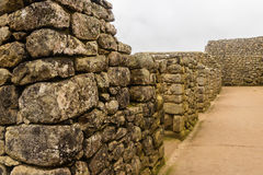 The plot of the wall. Of large stone in the lost Inca city of Machu Picchu in rainy weather Stock Photography