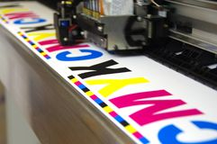 Plotter head printing CMYK Royalty Free Stock Image