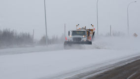 Plough and Salt. Plough clears the highway for traffic Stock Image