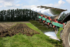 Plough and tractor Stock Photo
