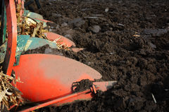 Plough on a tractor working in the field Royalty Free Stock Images