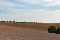 Ploughed autumn fields stock images