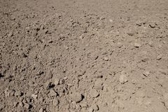 Ploughed brown clay soil agriculture fields. Ready to sow Royalty Free Stock Photo