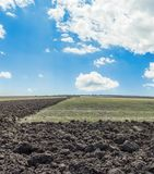 Agriculture field in autumn and clouds in blue sky. Ploughed field in autumn and clouds in blue sky Royalty Free Stock Images