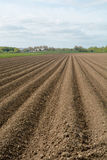 Ploughed field on farm Royalty Free Stock Photos