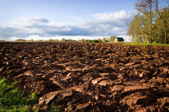 Ploughed field and house Royalty Free Stock Image